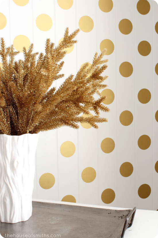 Gold polka dots on wall + gold Christmas decor - thehouseofsmiths.com